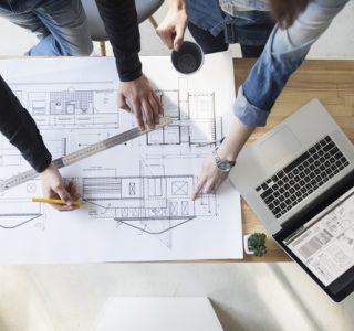 Architects hand working blueprint wooden desk work place