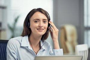 happy-caucasian-female-call-centre-worker-smiling-office_1098-17815